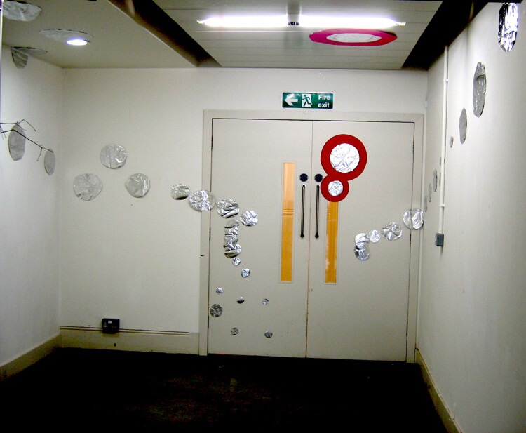 Silver Circles and a Twig, 2005, paper, silver foil and glue, variable size