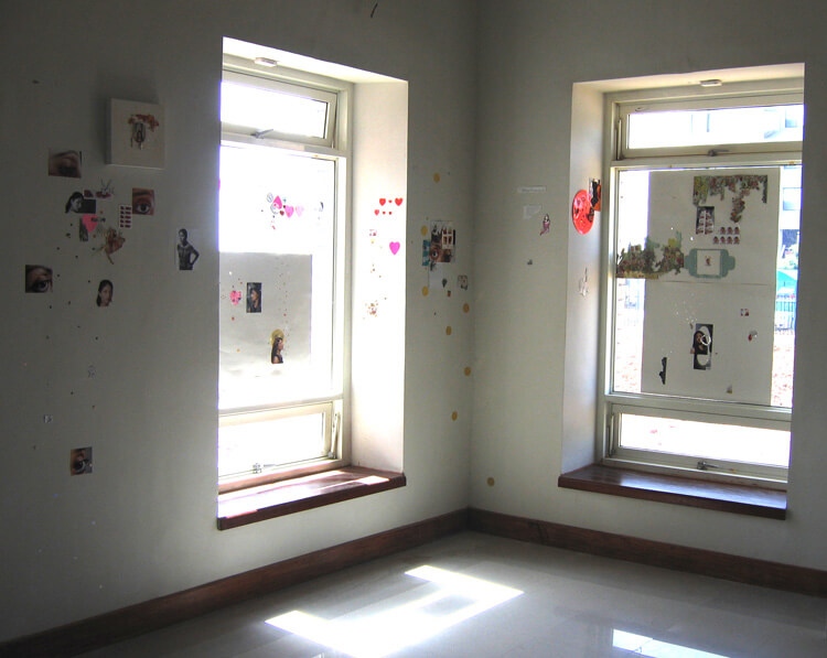 Butterflies, Fairies and Hearts, 2007, different types of paper, fabric, plastic and foam stickers and photograph prints, installation view